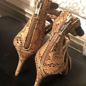 Snake skin and suede pumps